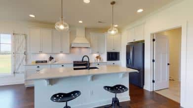 Jagoe Model HomesLittle Rock Craftsman w/ 3rd BayTurnberry at BerkshireNewburgh, INkitchen, kichler lighting, pendents, general electric, black slate appliances, stools, quartz countertops, hood, built-in microwave, straigh-lay cabinets, masterbrand white cabinets, farmhouse design